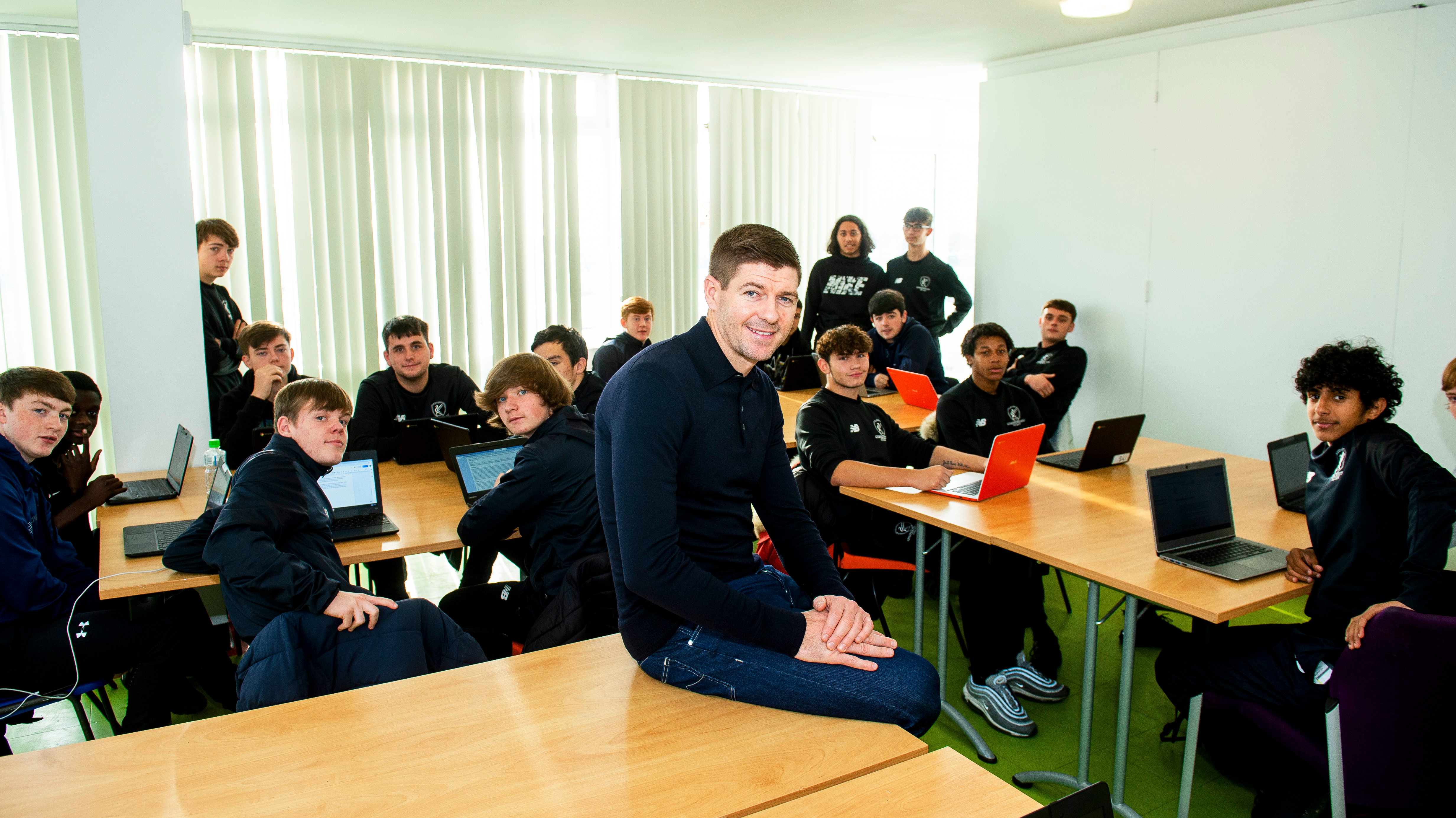Steven Gerrard at Liverpool Football College with students